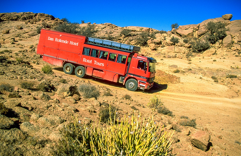 Not far from Todart city our truck rides on dirt track roads in between spheroidal weathered rocks.