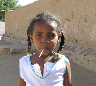 Girl, Karima.  This girl asked me to hold off on the photo until she put the lollipop in her mouth.