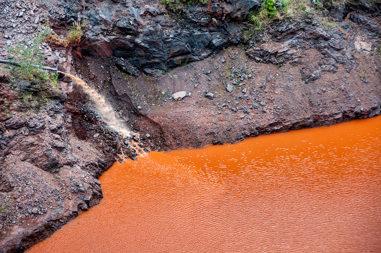 Iron ore streaming down onto the river in Malolotja, Swaziland
