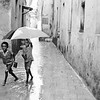 Zanzibar boys with umbrella in the rain