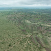 Boundary between Tanzanian farmland on right and Serengeti National Pakr on left.  Note trails from illegel entry of people and livestock into the Park.