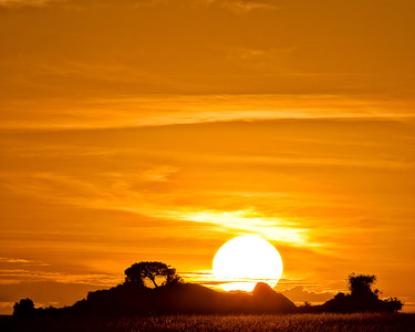 The sun rising quickly over a kopje in the Serengeti