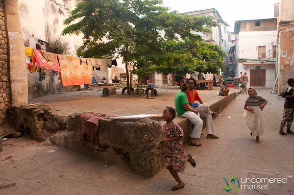 Girls Running Through Courtyard - Stone Town, Zanzibar