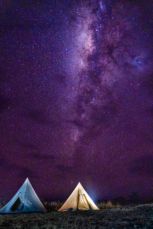 The Milky Way over tents in the Serengeti