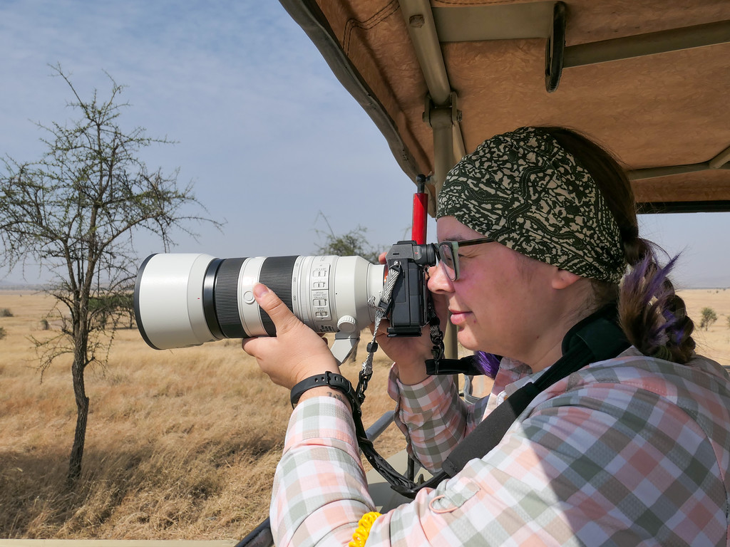 Amanda with a camera in the Serengeti