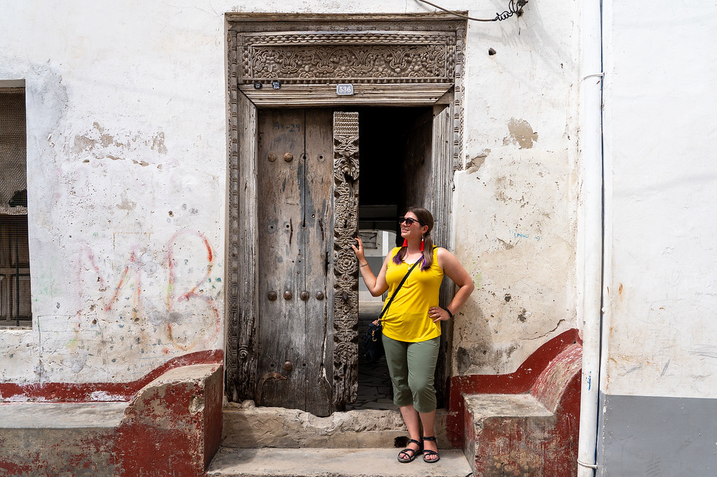 Amanda by a wooden door in Stone Town