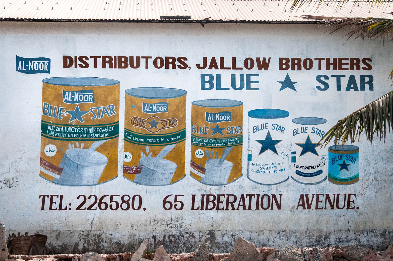 Painted commercial wall in Banjul, The Gambia