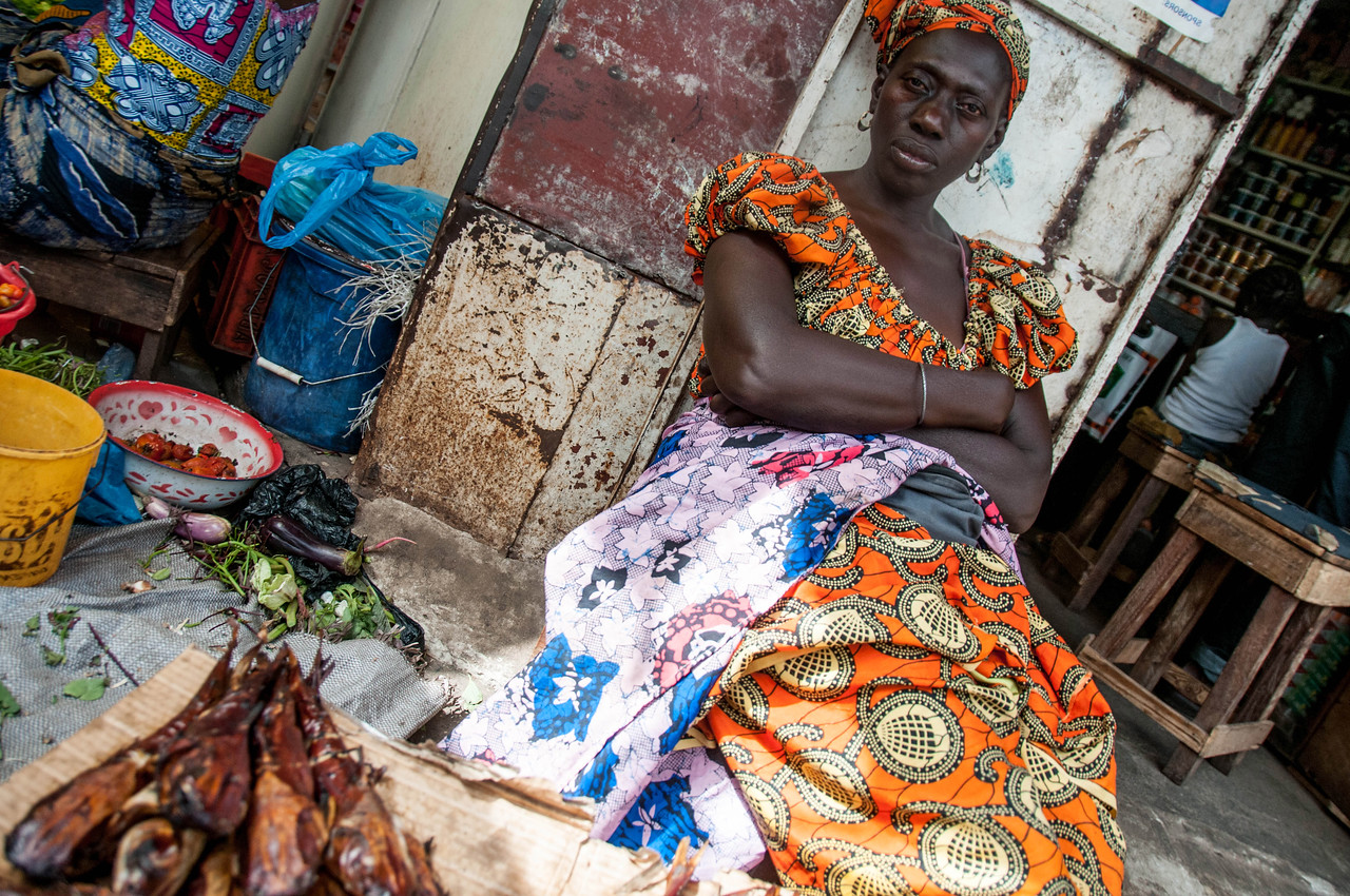 Woman selling fish in the market of Banjul, The Gambia