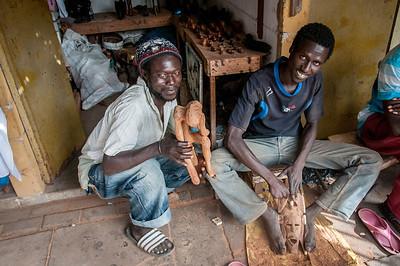 Locals making handicrafts in Banjul, Gambia