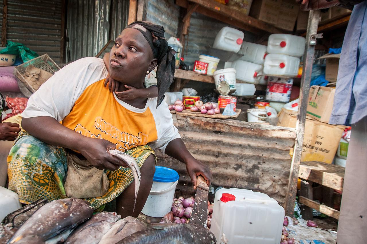 Woman selling fish in a market in Banjul, Gambia