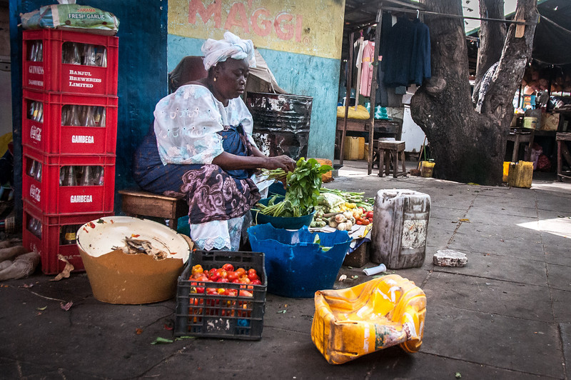 Woman selling vegetables at a market in Banjul, Gambia