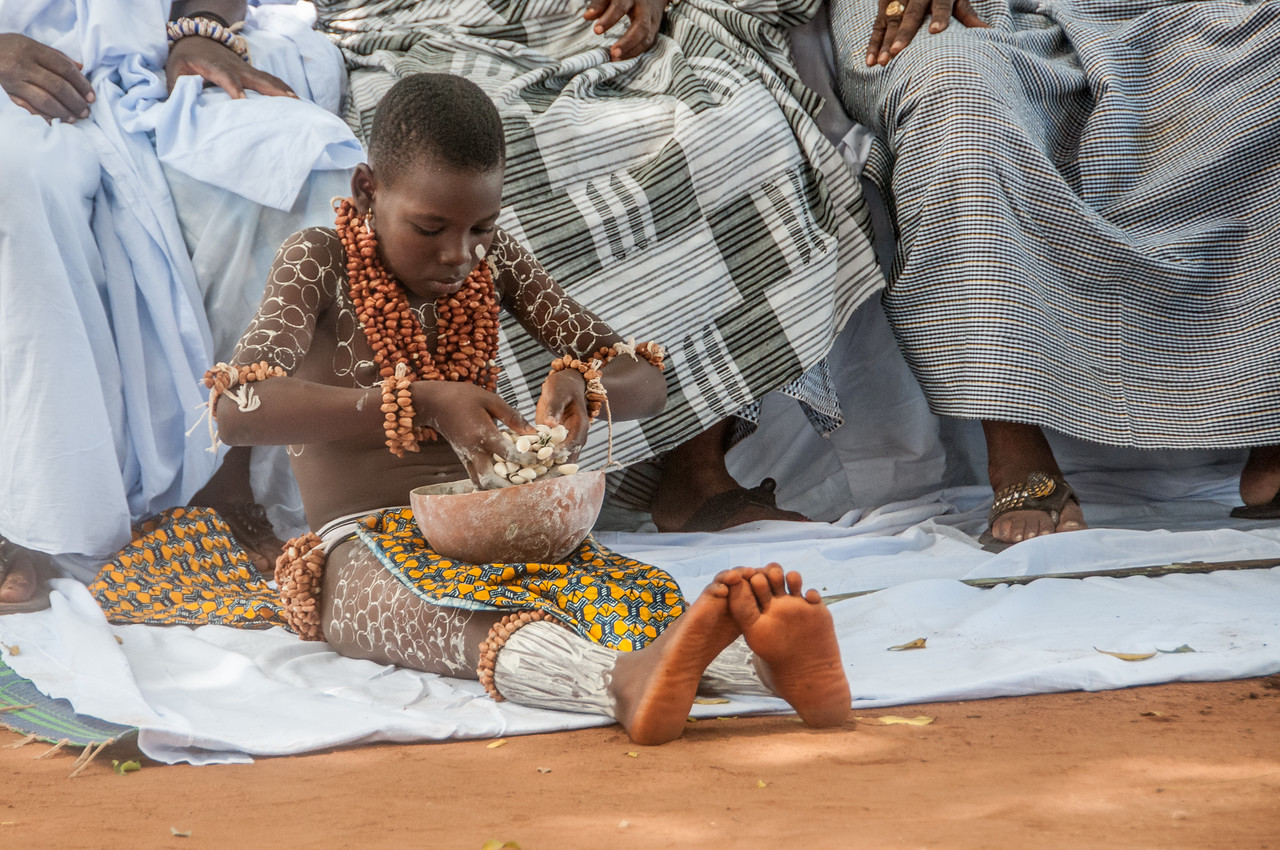 Young boy during traditional performance in Lome, Togo