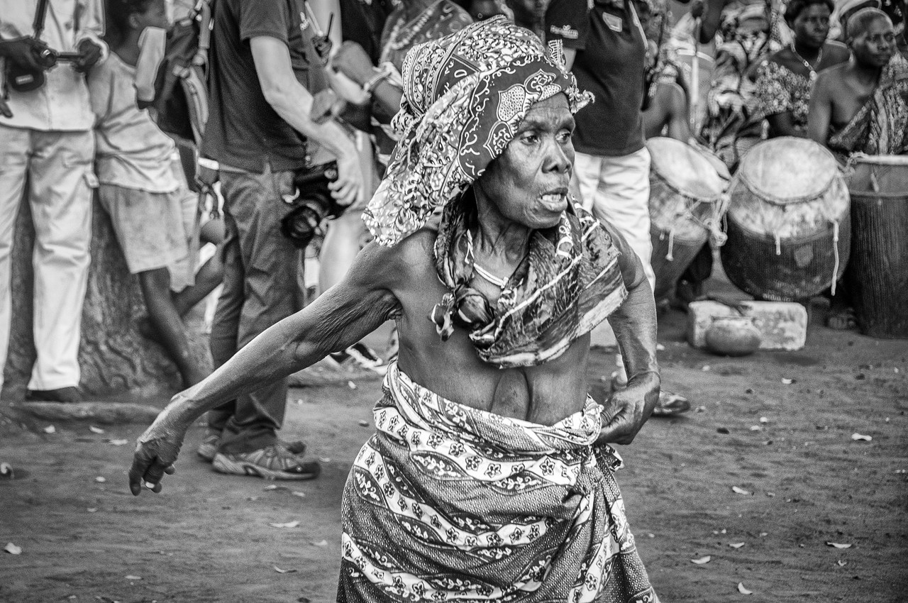 An old woman performing in Lome, Togo