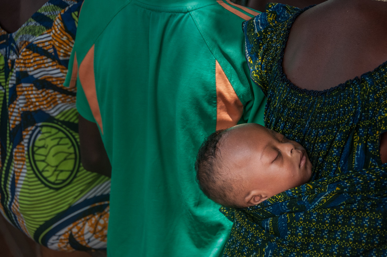 Sleeping child on mother's back in Lome, Togo
