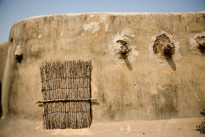 TAMBERNA VALLEY, TOGO - DECEMBER, 2006: A wall on the roof of a tat house. Located in the North of Togo, the Tamberma Valley is famous for it castle like mud houses called Tata. (Photo by: Christopher Herwig)