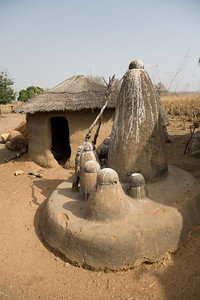 TAMBERNA VALLEY, TOGO - DECEMBER, 2006: Posts used in local rituals.  Located in the North of Togo, the Tamberma Valley is famous for it castle like mud houses called Tata. (Photo by: Christopher Herwig)