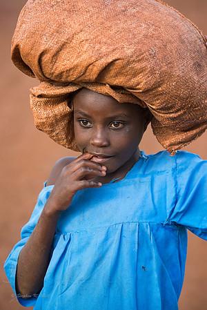 Girl in blue dress. Kyabirwa, Uganda