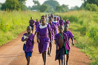 School's out. Beginning the long walk home. Lira district, northern Uganda