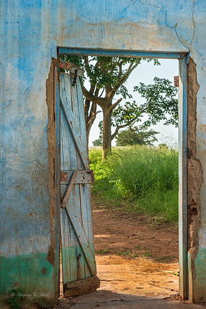 Open door, abandoned church, early morning. Gulu district, northern Uganda
