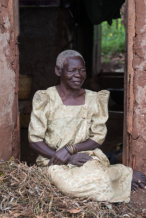 Village matron in doorway. Kamuli district, Uganda