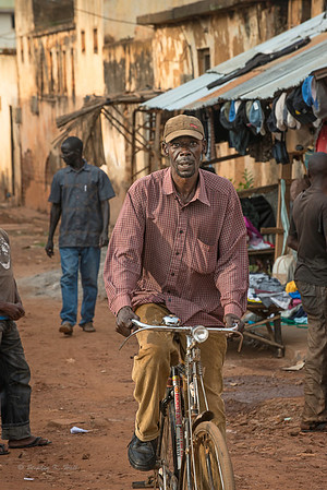 Bicycling to town. LIra, Uganda