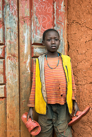 Young boy with shoes. Mbarara district, Uganda