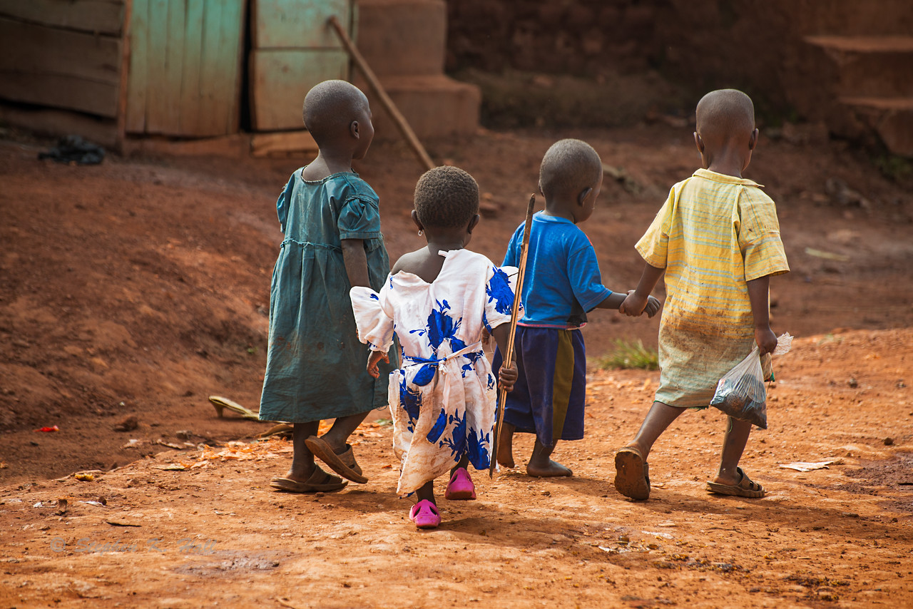 """Guys, we've got your back."" Together four young friends venture into town. Mafubira, Jinja District, Uganda."