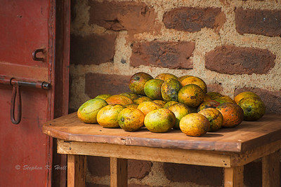 Mangos and red door. Mafubira, Uganda