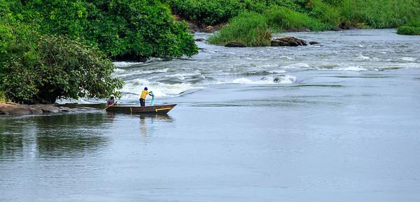 Fishermen hauling net, Busowoko Falls, Victoria Nile, Uganda