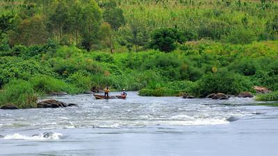 Fisherman hauling net, Busowoko Falls, Victoria Nile, Uganda