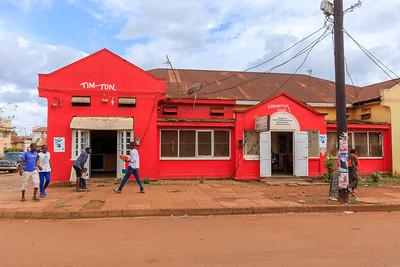 Red building in Gabula Road, legacy of indian architecture in Jinja, Uganda