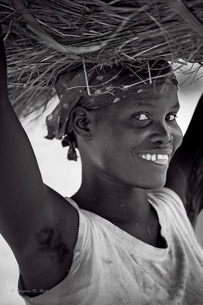 Young girl, morning chores. Patiko, Gulu district, Uganda