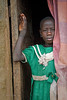 Young girl in doorway. Acholi IDP resettlement camp. Jinja, Uganda