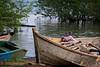Young boy playing in idle fishing boat. Lake Victoria, Mayuge District, Uganda