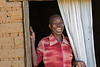 Acholi woman in doorway. Pabo IDP resettlement camp, Gulu district, northern Uganda