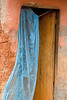 Blue curtain and door.  Acholi IDP settlement. Jinja, Uganda