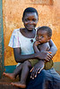 Mother and child, seated. Budongo, Uganda