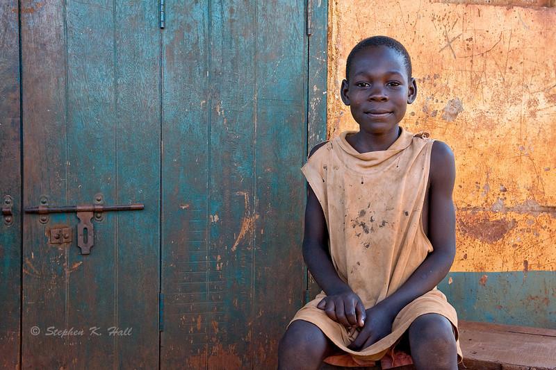 Young boy, sitting.  Budondo, Uganda