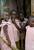 Primary school children with brooms. Bugembe, Uganda