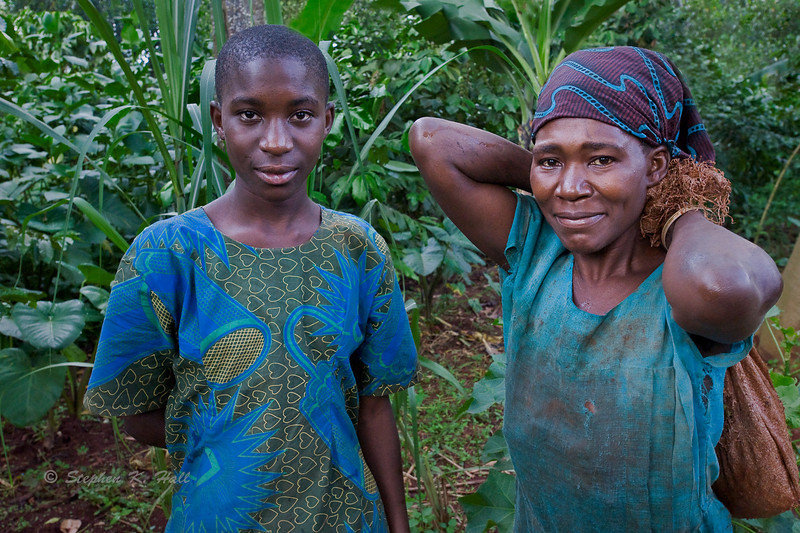 Mother and daughter, picking coffee. Bujagali, Uganda