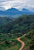 Red earth road and Virunga Mountains. Southwestern Uganda