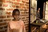 Vigilant. Young boy and watchful grandmother. Buwenge, Uganda
