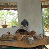 Traditional Healer in his hut with medicines and herbs. Bwindi, Uganda