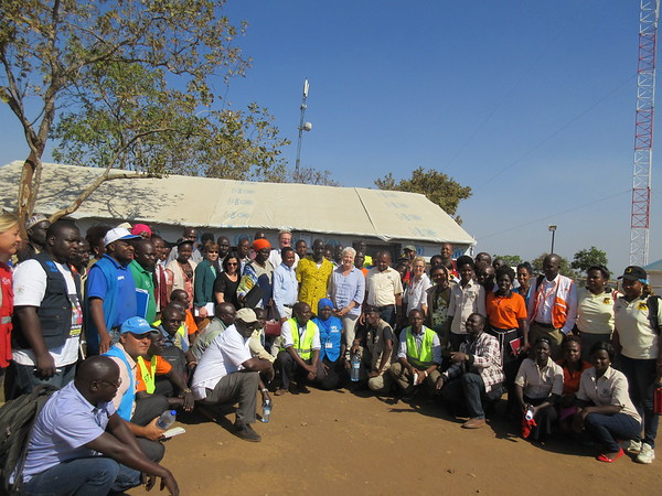 Partners operating in Bidibidi Refugee Settlement in a group photo with the US Ambassador to Uganda