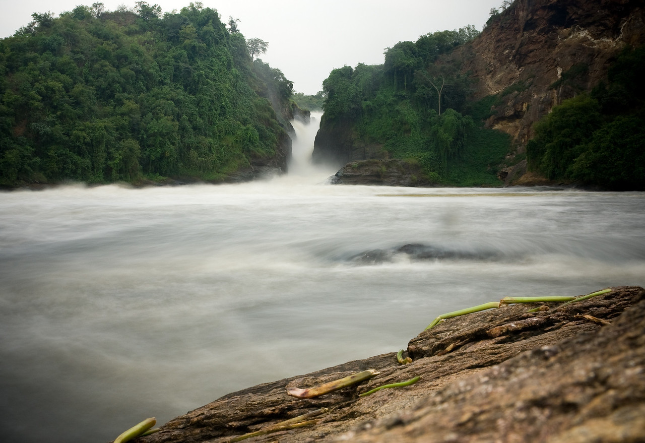 Local tour guides say Murchison Falls is the most powerful waterfall in the world.  While that claim isn't actually true, when you see the 100-meter wide raging, class 5 whitewater-filled Nile river squeeze down to shoot the 7 meter-wide gap in the rocks, you can easily see how they might believe that.<br /> <br /> Between using a small aperture and a ND filter, I accomplished a longish exposure that blurred the water nicely despite it being bright mid-day light.<br /> <br /> Location: Murchison Falls National Park, Uganda<br /> <br /> Lens used: 24-105mm f4.0 IS w/Vari-ND Duo filter