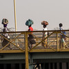 Women crossing the railway bridge to Zambia