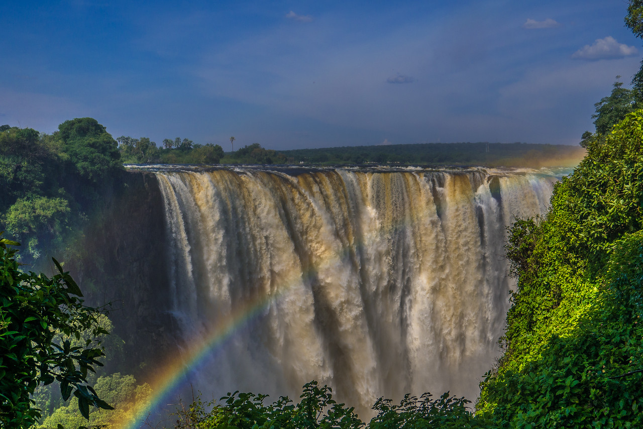 Rainbows over Victoria Falls in January when the Zambezi River is full.