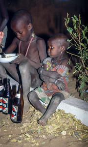 We camp near a Hotel. And as we sit around our truck in the evening two children, brother and little sister, join us and we are happy to share our supper with them.