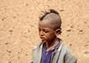 Traces of life in the desert on childrens' faces.