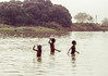 Village boys bathing in the river and greeting us.